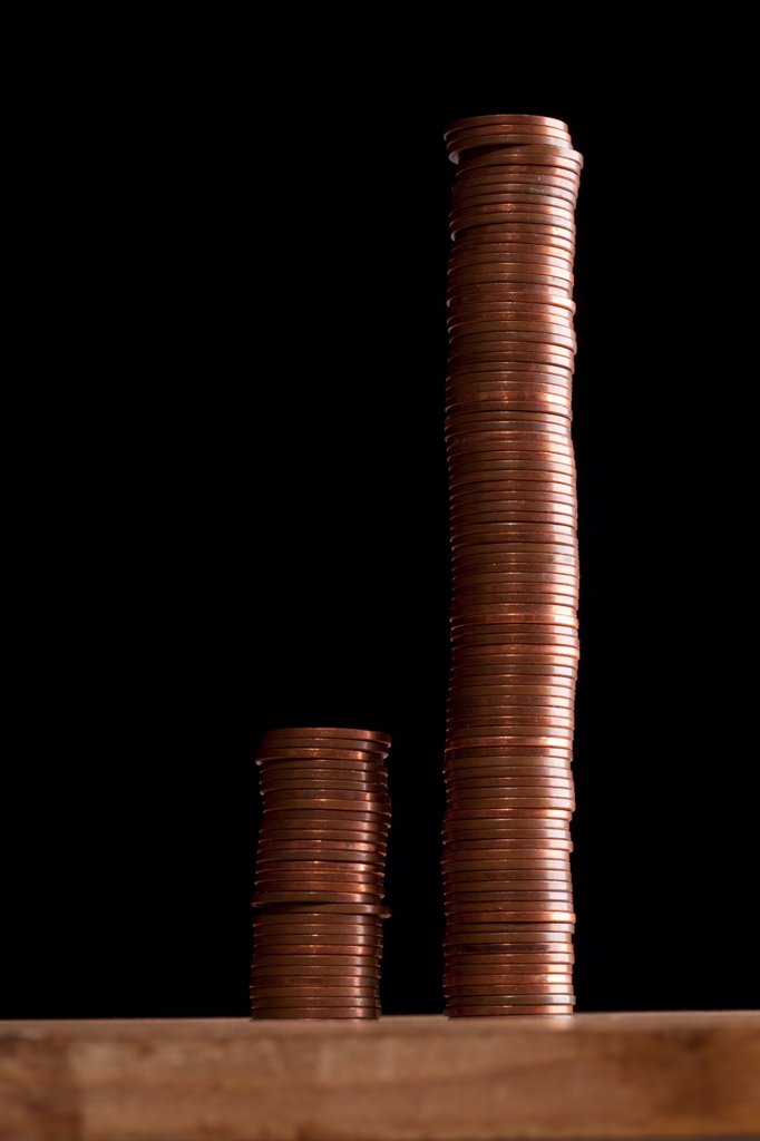 Stock Photo: 1570R-140798 Two different sized stacks of copper coins side by side
