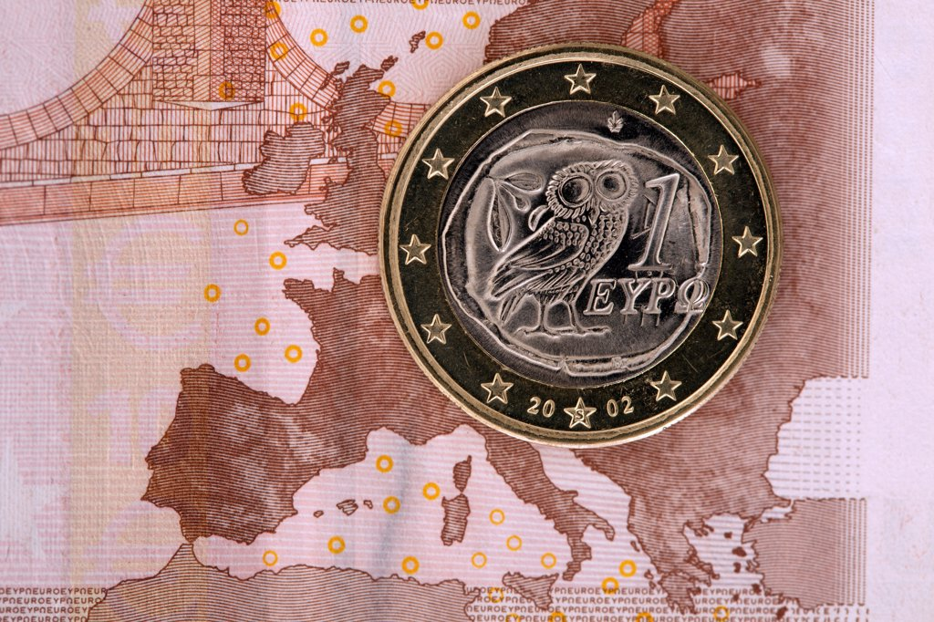 Detail of a ten Euro banknote with a one Euro coin on top of it : Stock Photo