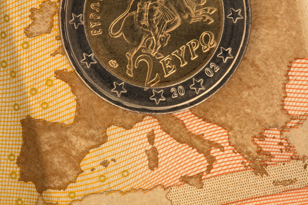 Detail of a fifty Euro banknote with a two Euro coin on top of it : Stock Photo