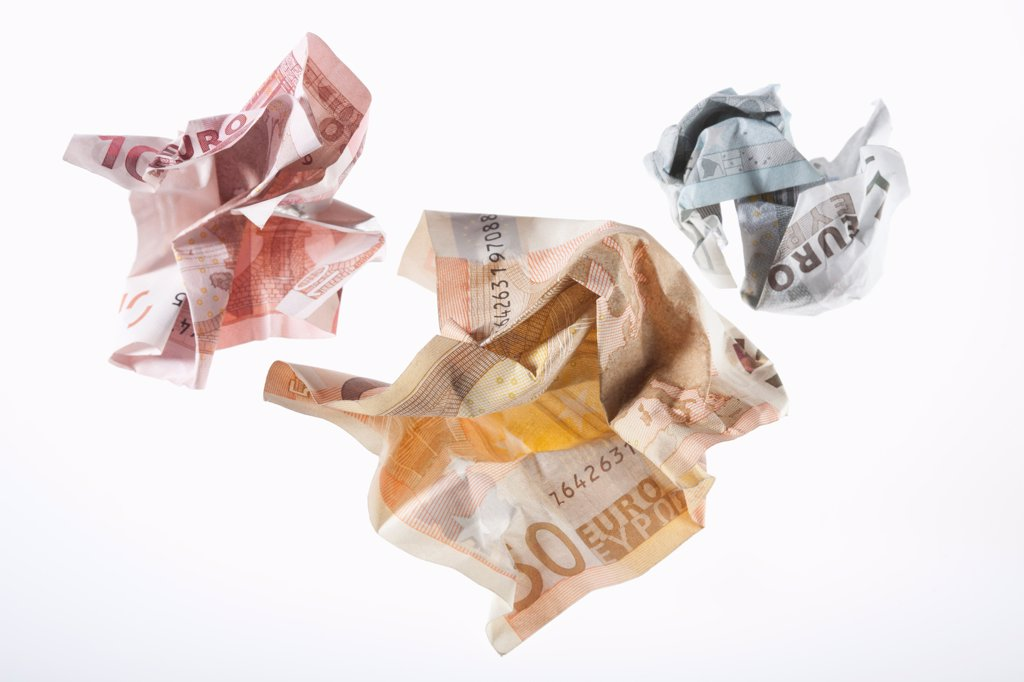 Stock Photo: 1570R-140858 Crumpled Euro banknotes on a white background