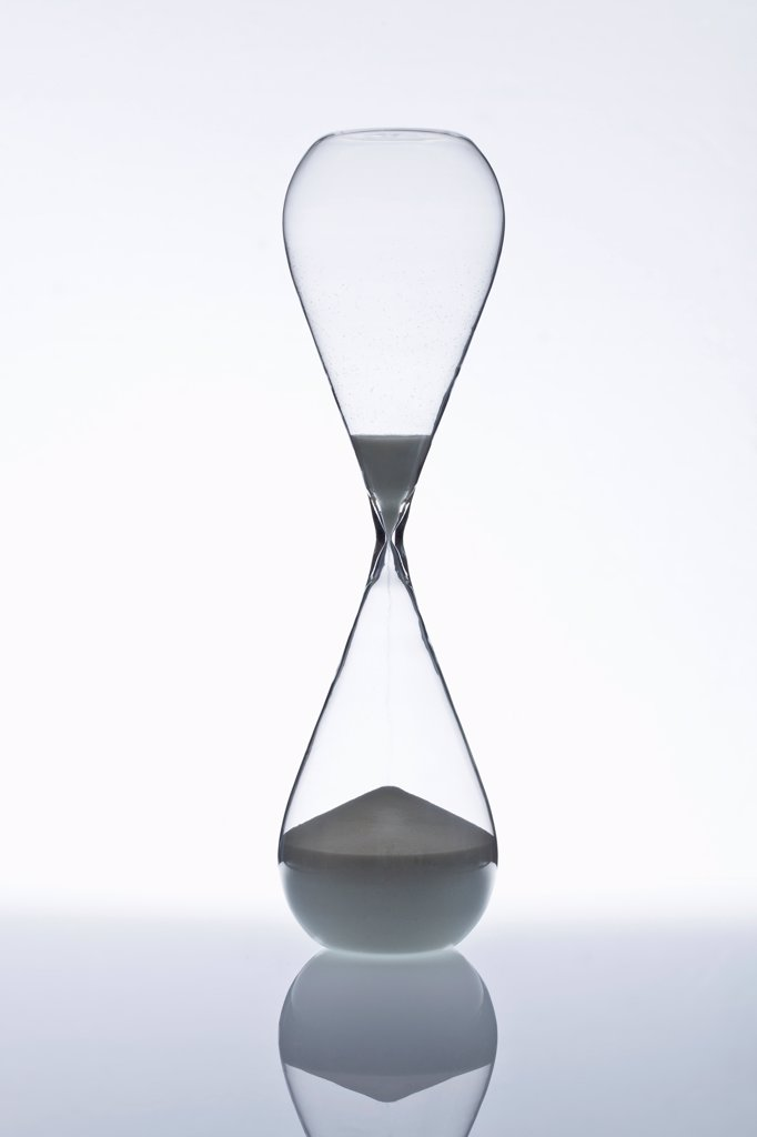 Stock Photo: 1570R-140902 Sand running through an hourglass
