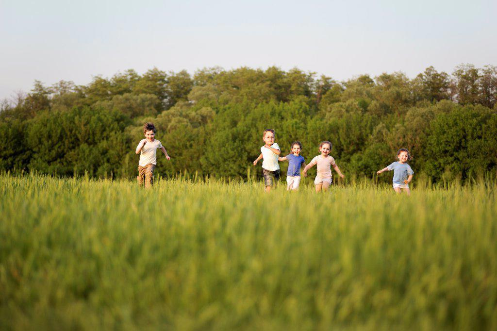 Stock Photo: 1570R-141055 Children running in a field