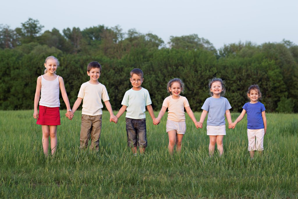 Stock Photo: 1570R-141058 Portrait of children holding hands in a field