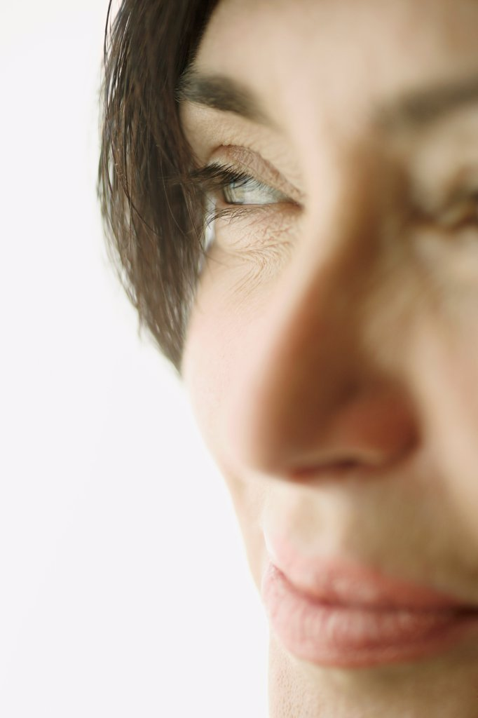 Detail of a mature woman looking away : Stock Photo
