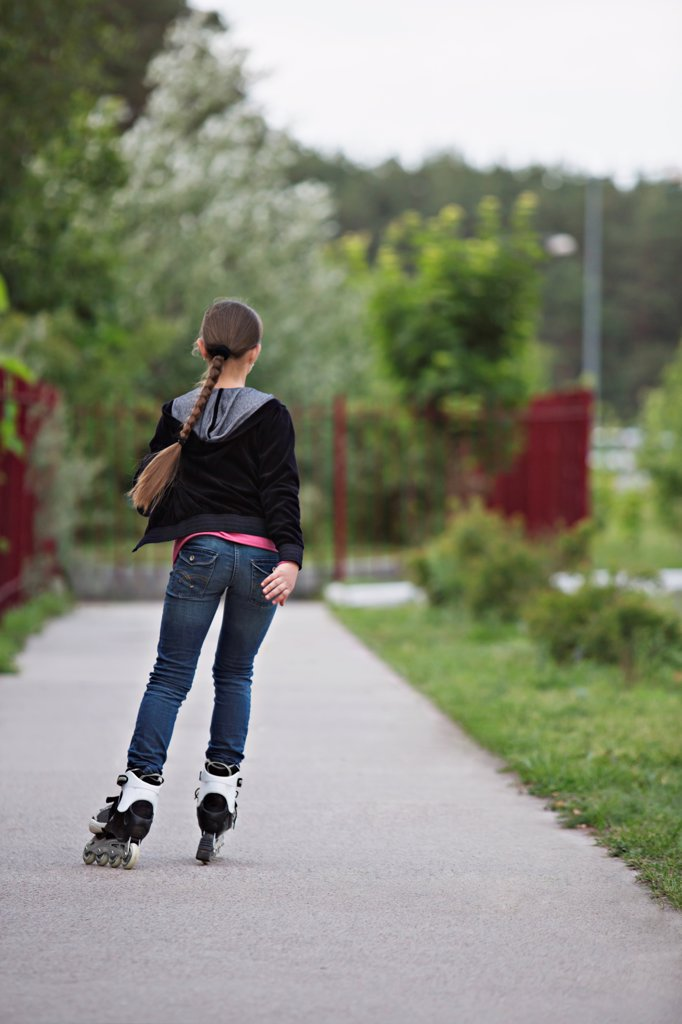 Stock Photo: 1570R-141089 Rear view of a girl inline skating