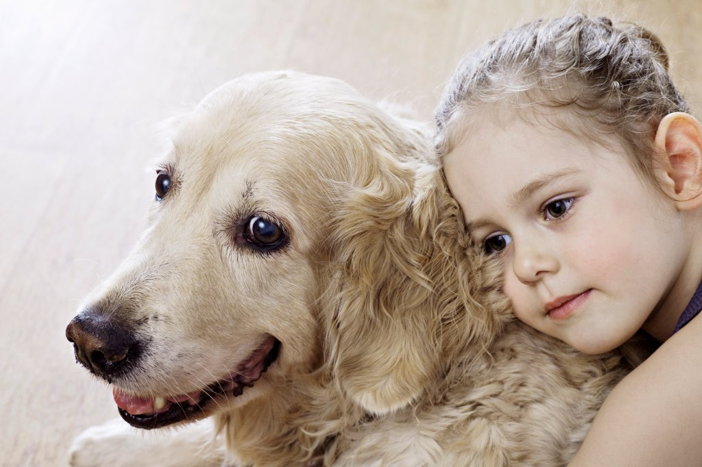 Stock Photo: 1570R-141149 Close-up of a young girl hugging a dog