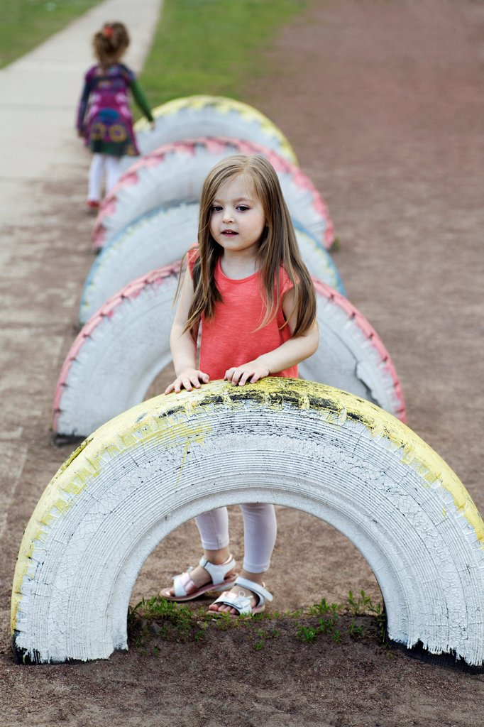 Stock Photo: 1570R-141166 A young girl in a playground