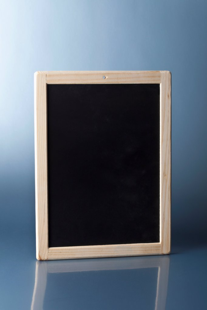 Stock Photo: 1570R-141197 A small blank chalkboard standing upright