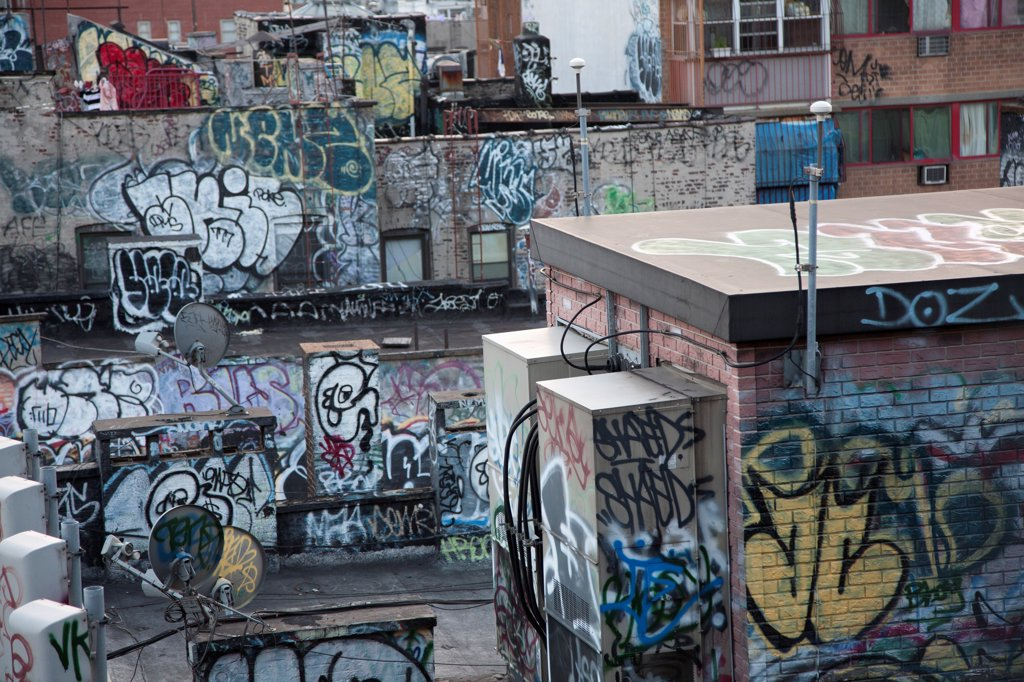 Stock Photo: 1570R-141325 Graffiti covered tenement rooftop in Chinatown