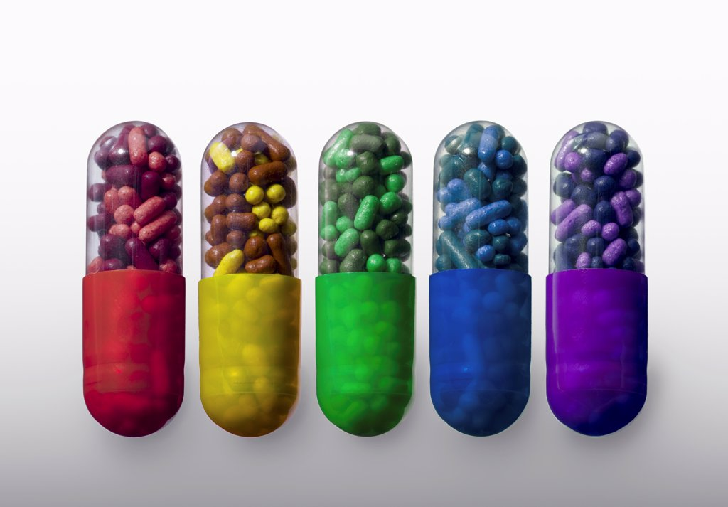 Stock Photo: 1570R-141525 A row of vibrantly variously colored capsule pills, close-up
