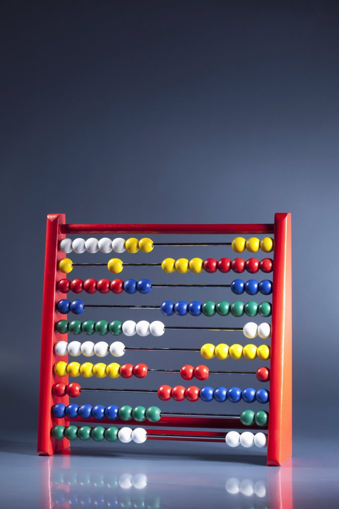An abacus with multi colored wooden beads : Stock Photo