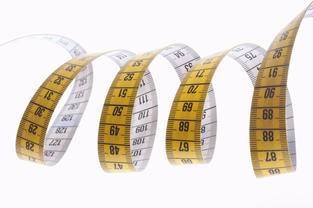 A centimeter tape measure arranged in a spiral shape : Stock Photo