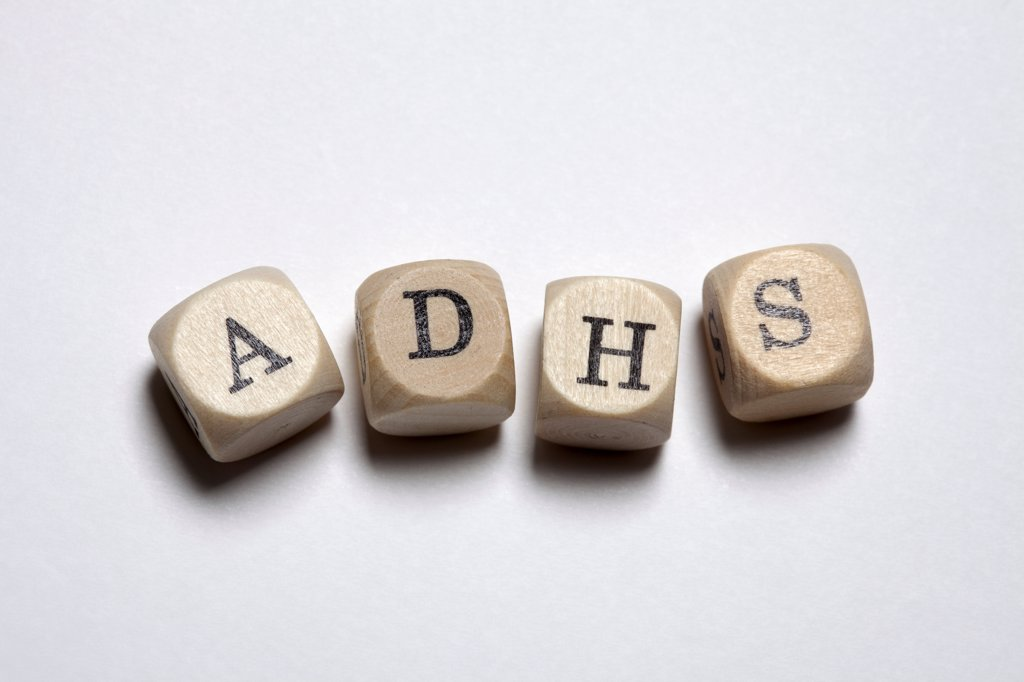 Stock Photo: 1570R-141593 Lettered cubes spelling ADHS, the German acronym for Attention Deficit Hyperactivity Disorder