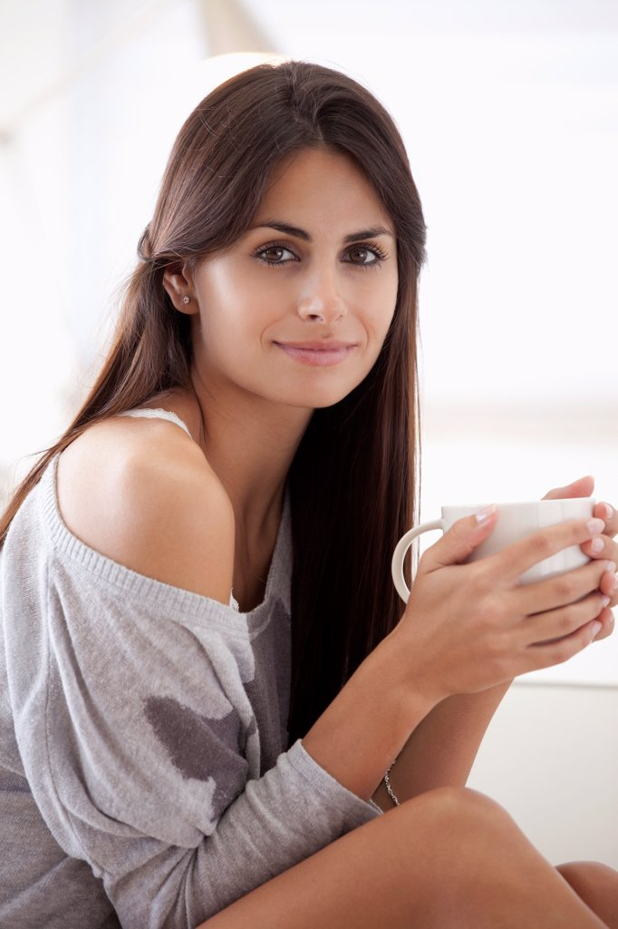 Stock Photo: 1570R-141668 Comfortable woman holding coffee cup