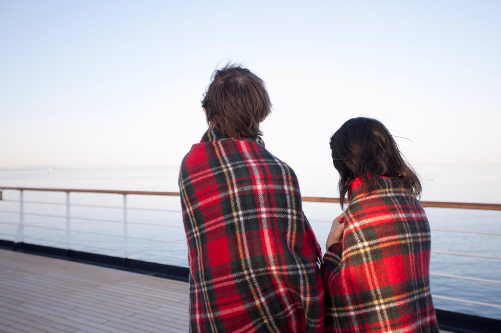 Stock Photo: 1570R-141685 A couple on a ship deck, wrapped in blankets, looking at view, Seattle, Washington, USA