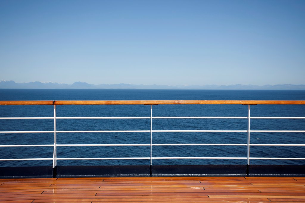 Stock Photo: 1570R-141694 Sun shining on the boat deck of a passenger ship, Canadian coastline in background