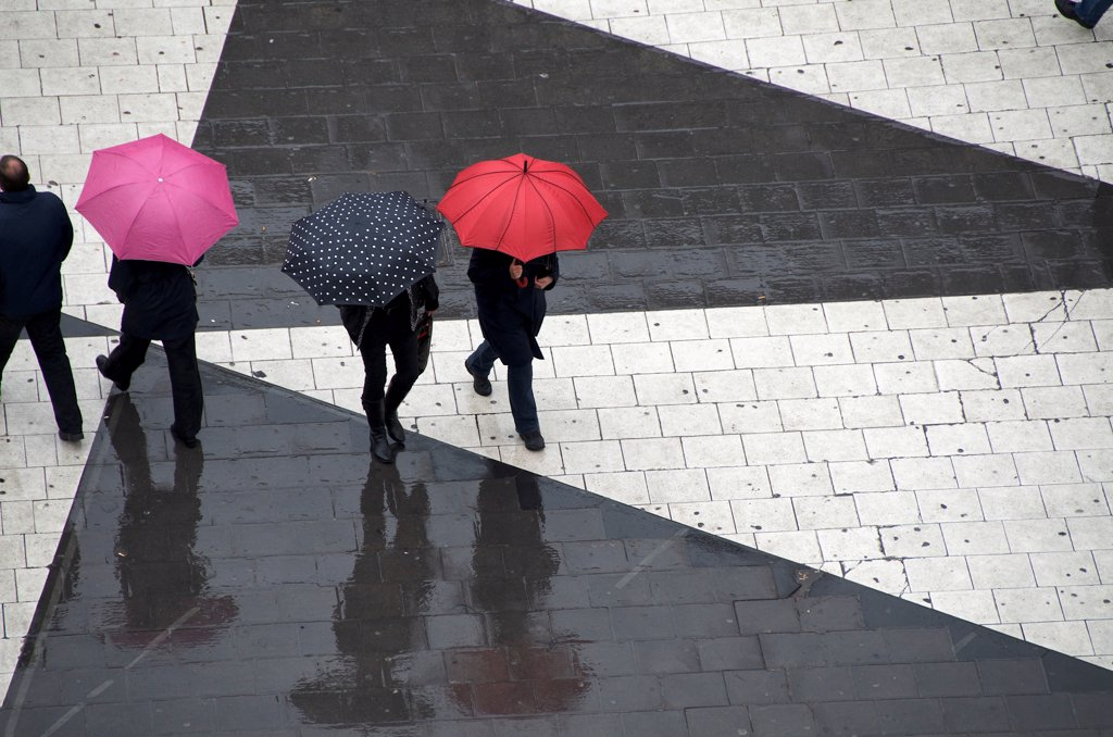 Stock Photo: 1570R-141719 Pedestrians below with umbrellas
