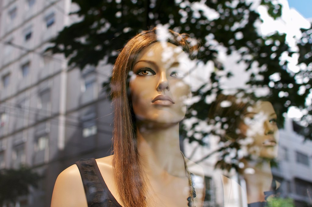 Stock Photo: 1570R-141737 Mannequins looking at the street buildings