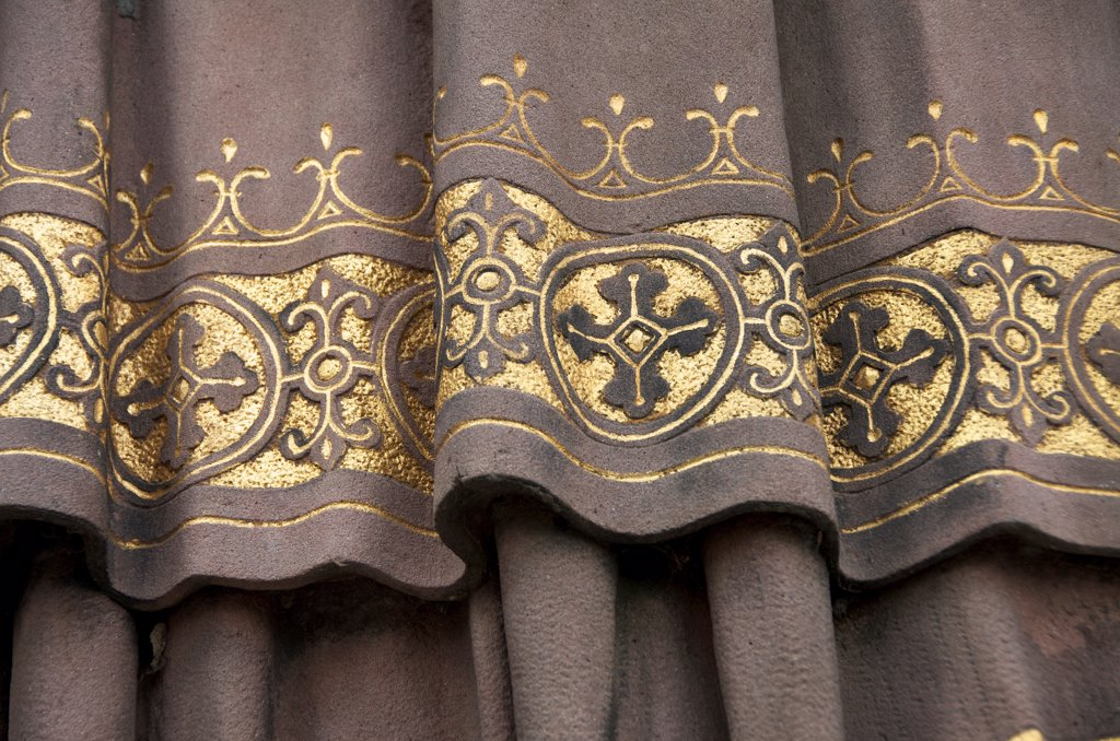 Golden detail of garment on clerical statue of Saint Ansgar : Stock Photo