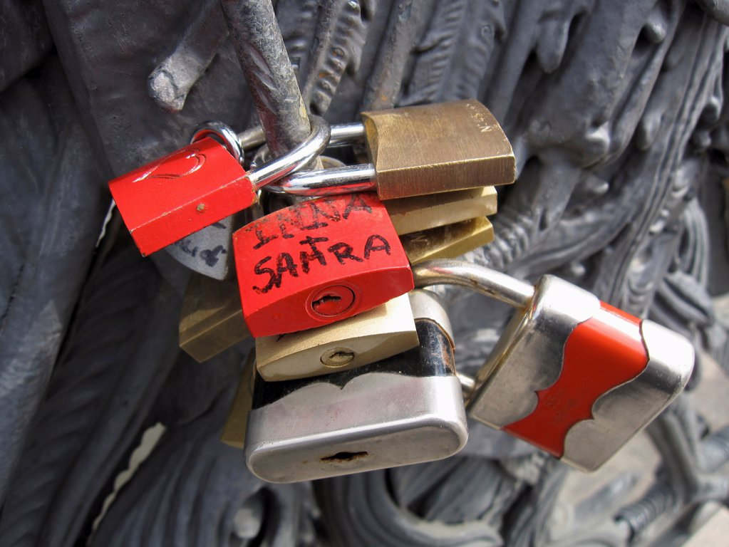 Stock Photo: 1570R-141747 Lovelocks of passion on a bridge, attached by couples as a symbol their devotion