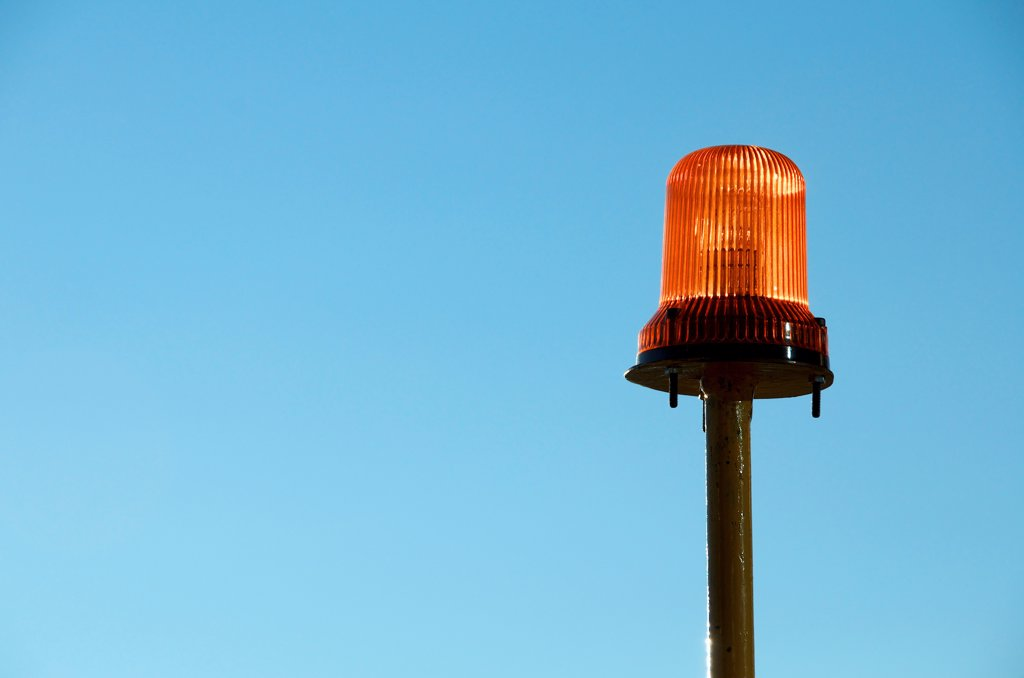 Stock Photo: 1570R-141766 Warning light with blue background of sky