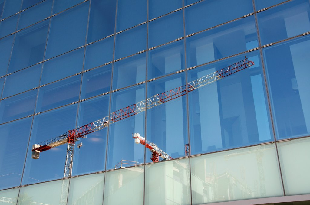 Stock Photo: 1570R-141771 Reflection of cranes on office building
