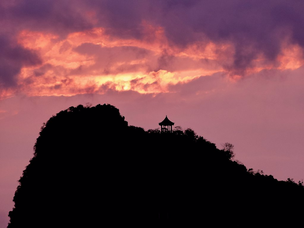 Stock Photo: 1570R-141815 A pagoda on a hill in silhouette against a dramatic sky, Guilin River, Guilin, China