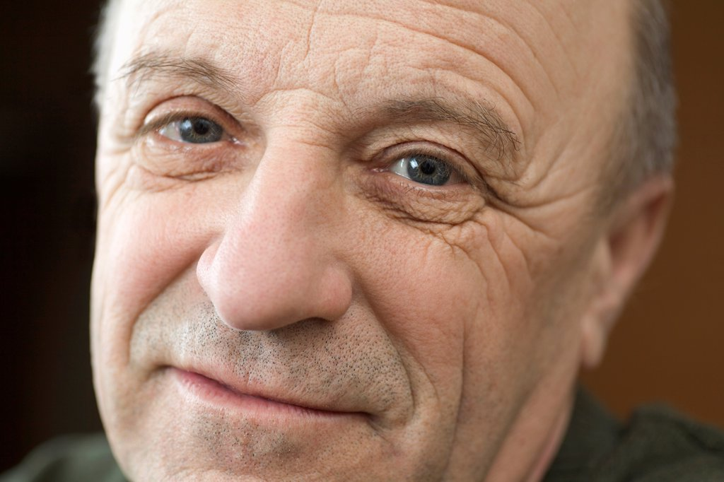 Stock Photo: 1570R-141914 A senior man looking optimistic, close-up