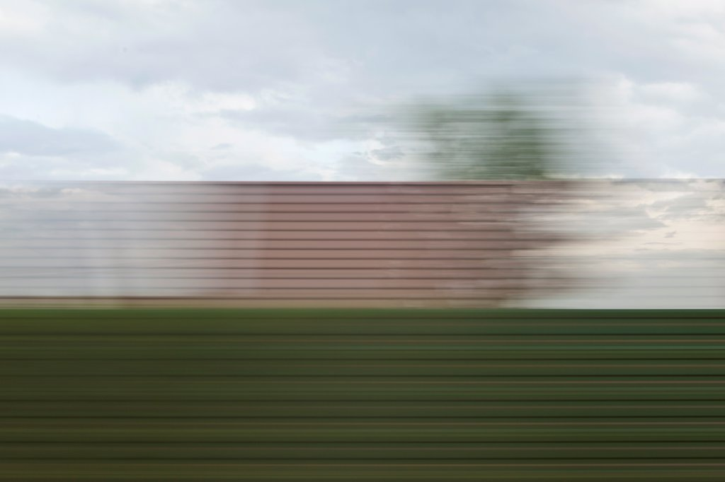 Stock Photo: 1570R-141989 A building and sky in blurred abstract pattern seen from moving train