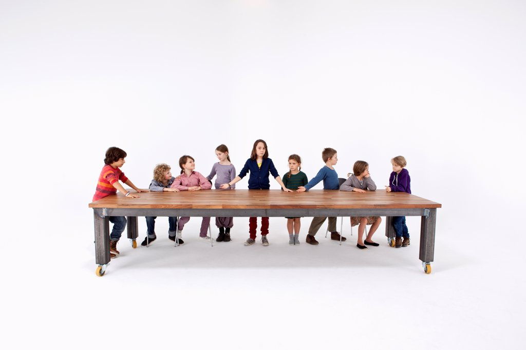 Nine kids arranged to imitate Leonardo Da Vinci's The Last Supper : Stock Photo