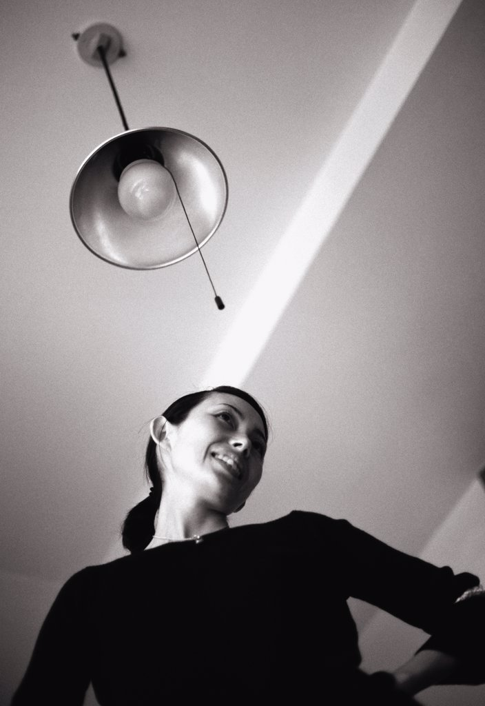 Stock Photo: 1570R-16014 view of a smiling woman from below