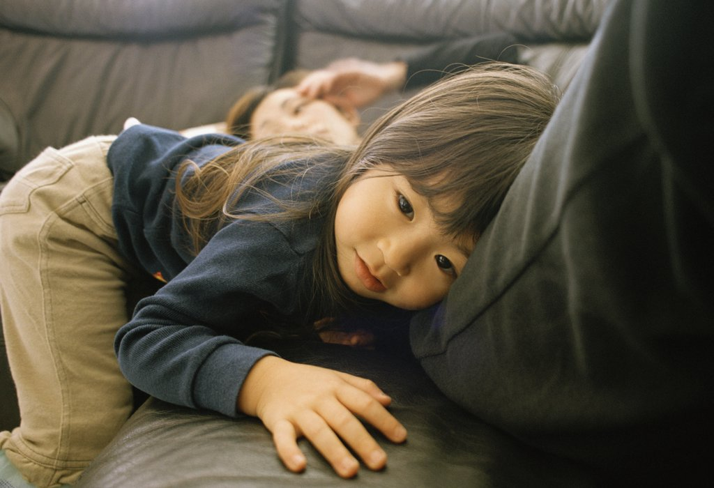 Stock Photo: 1570R-48012 Daughter resting next to mother