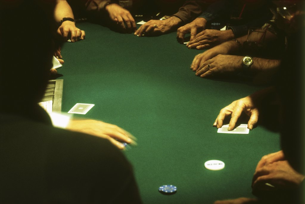 Stock Photo: 1570R-50002 group of people gambling at a casino blackjack table
