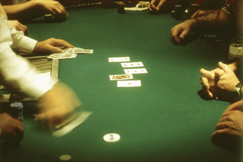 group of people gambling at a casino blackjack table : Stock Photo