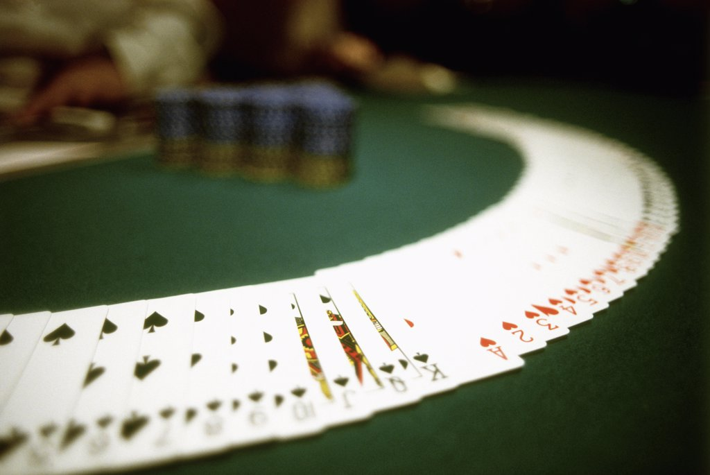 deck of cards on a poker table : Stock Photo