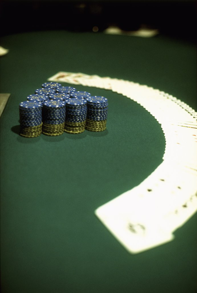 Stock Photo: 1570R-50010 chips and cards spread out on a casino table