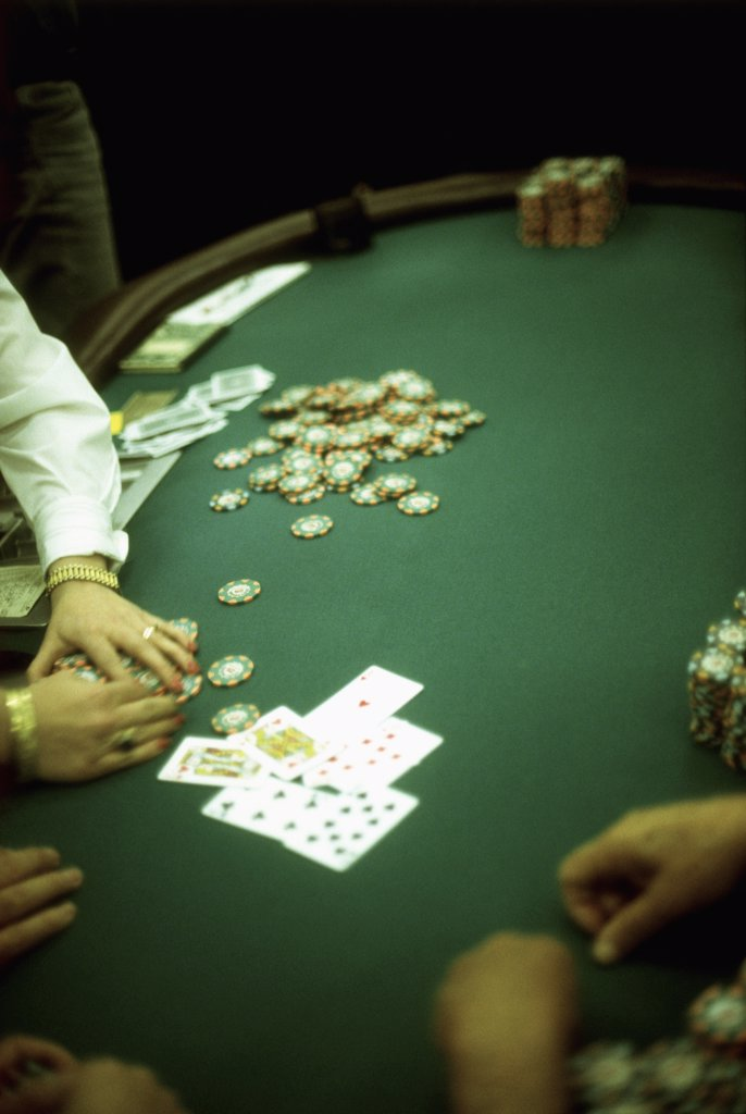 people playing blackjack at a casino : Stock Photo