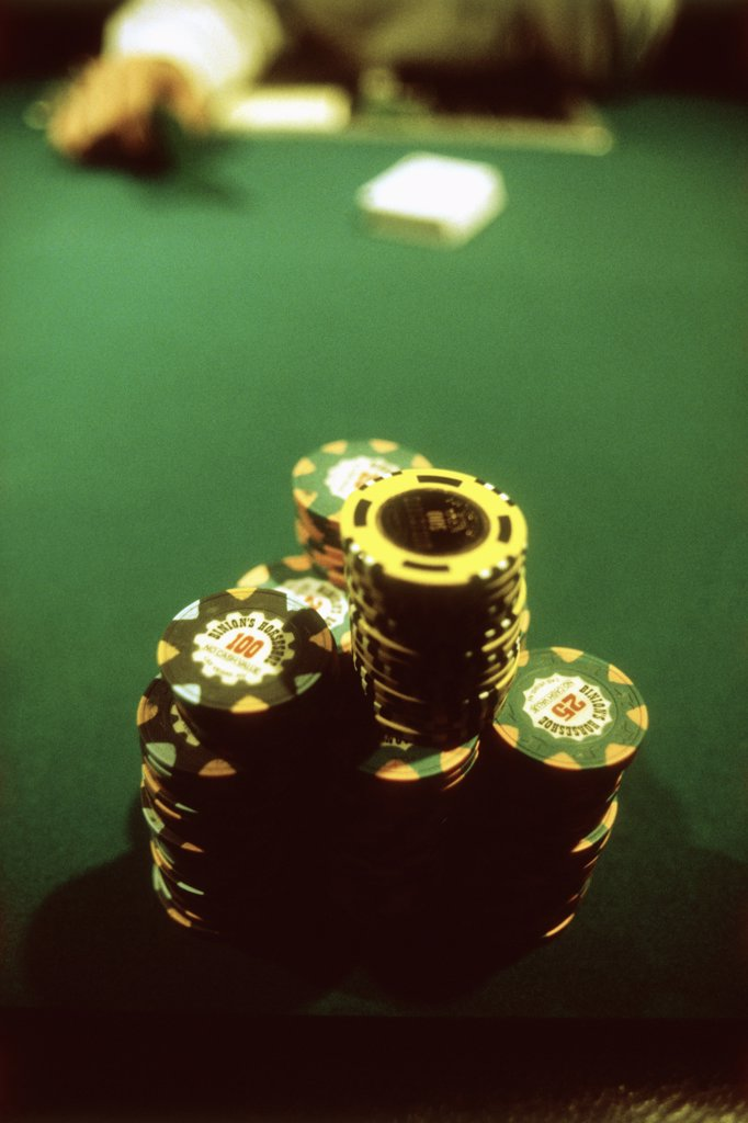 Stock Photo: 1570R-50022 Casino chips on a poker table