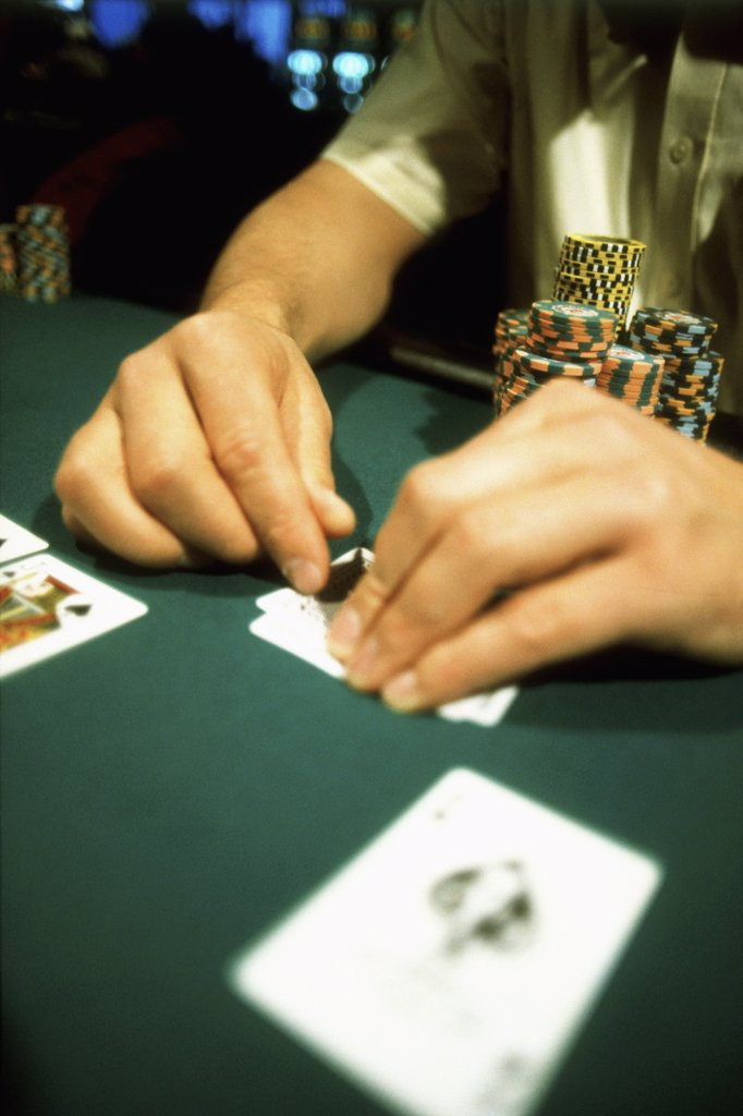 Detail of a man playing blackjack at a casino : Stock Photo