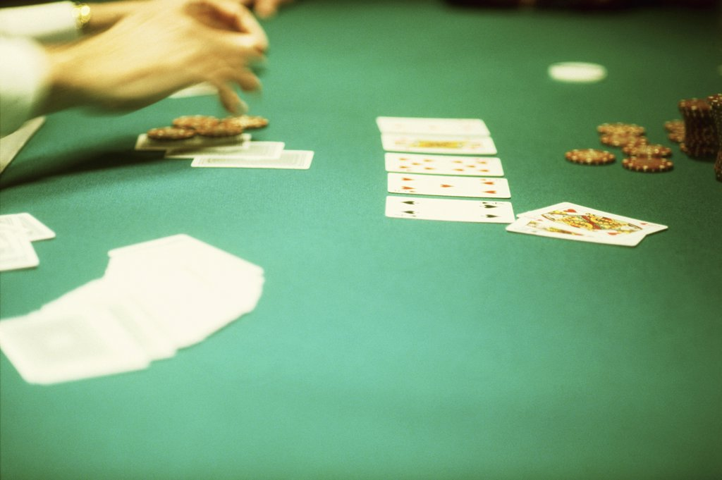 Detail of people playing blackjack at a casino : Stock Photo
