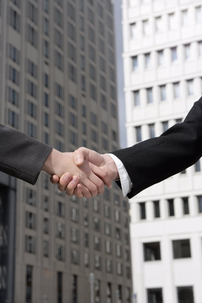Stock Photo: 1570R-78033 Two businesspeople shaking hands