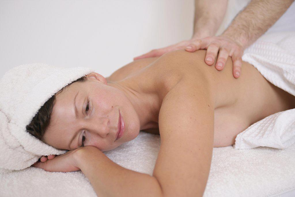 Stock Photo: 1570R-79015 A massage therapist massaging a woman's back