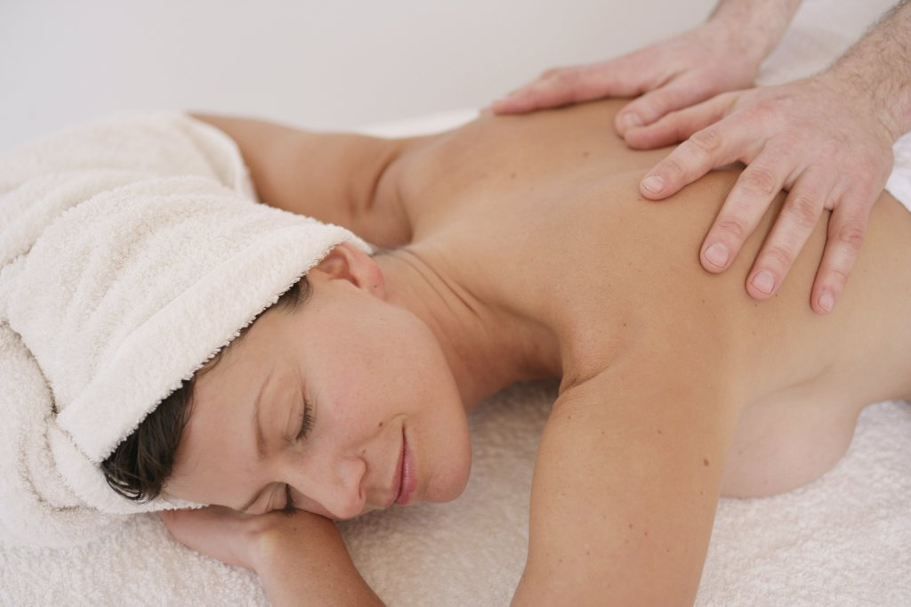 Stock Photo: 1570R-79016 A massage therapist massaging a woman's back