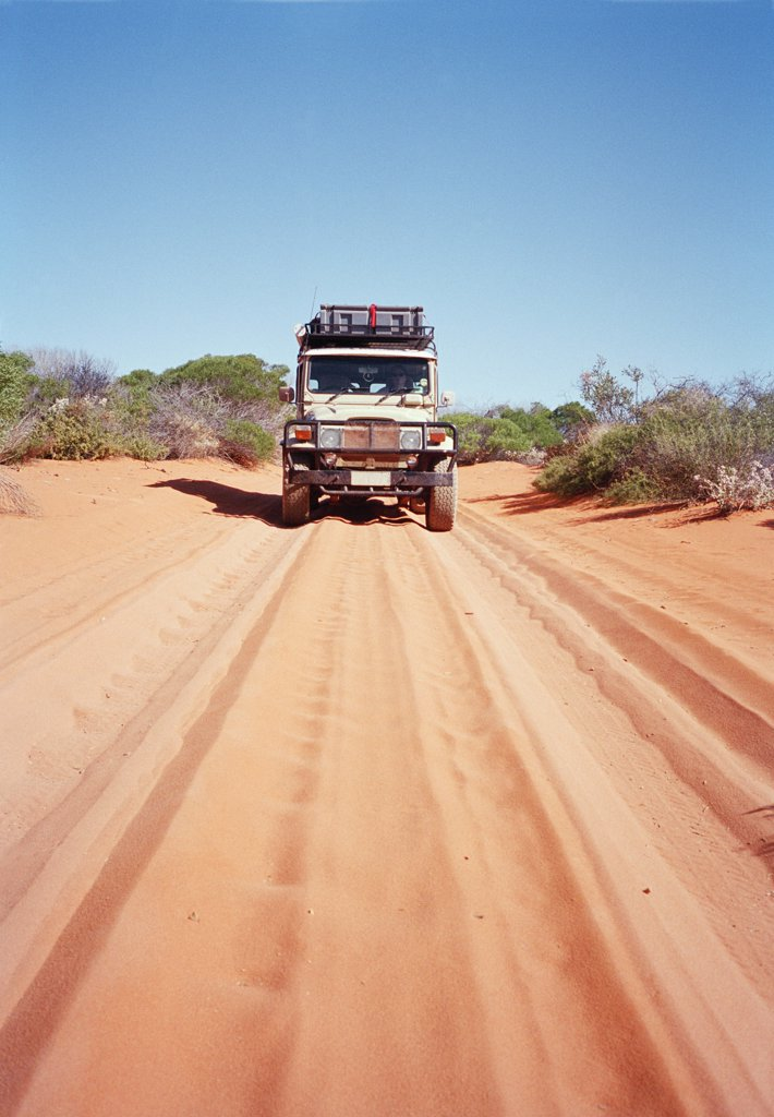 An off-road vehicle on a desert road in Australia : Stock Photo