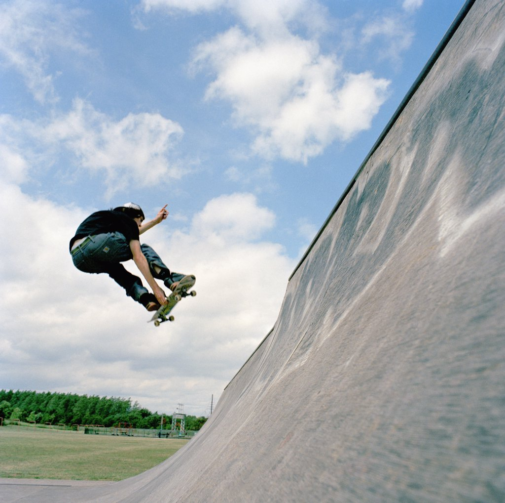 Skateboarder, mid-air : Stock Photo