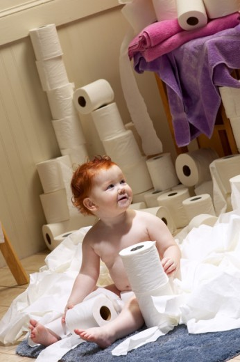 Stock Photo: 1574R-010084 Baby playing with toilet paper rolls