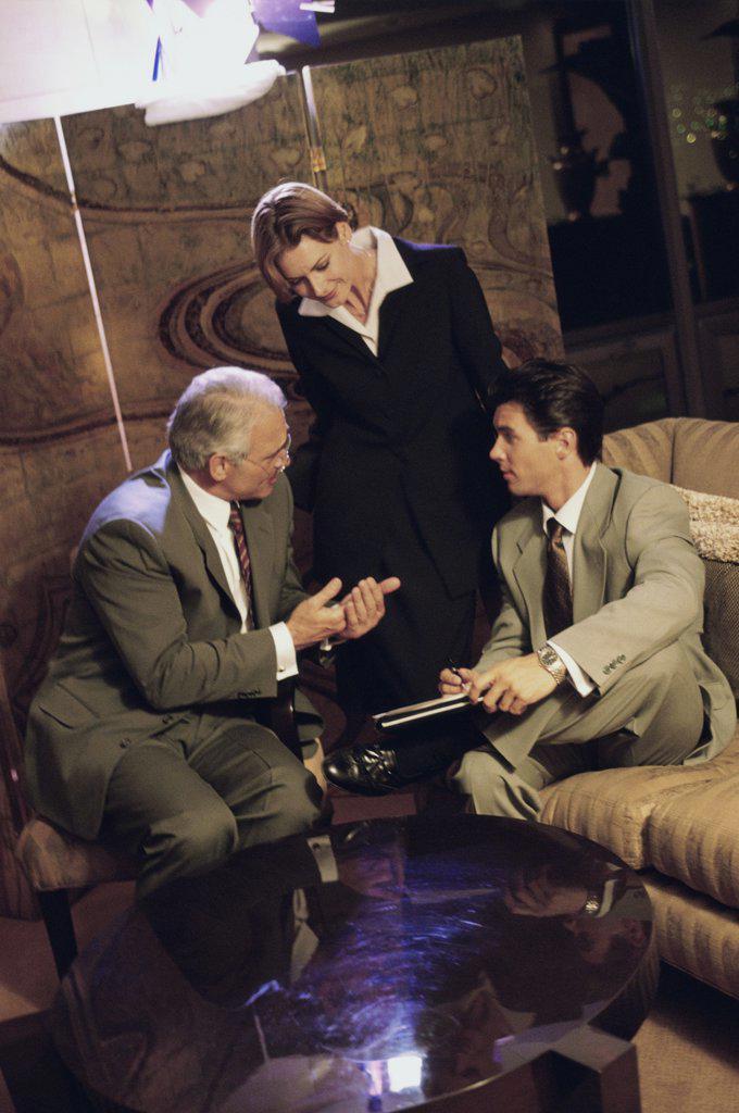 Stock Photo: 1574R-01008A Three business executives talking
