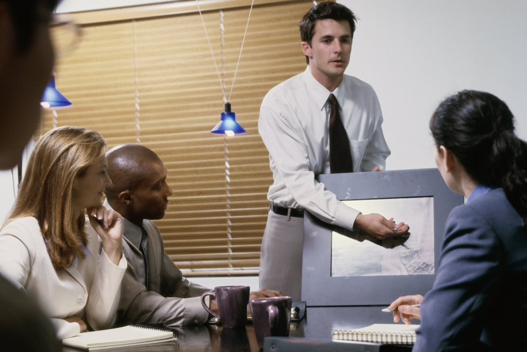 Stock Photo: 1574R-01032 Business executives at a presentation in a conference room