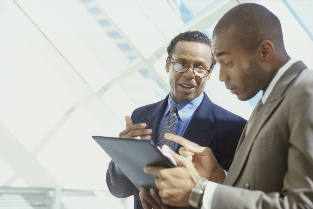Stock Photo: 1574R-01053B Two businessmen talking