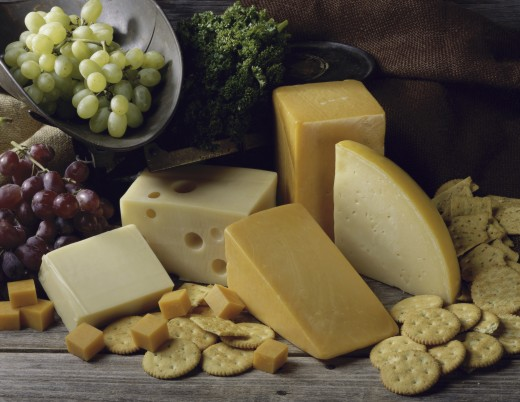 Stock Photo: 1574R-010802 Close-up of cheese with crackers and grapes